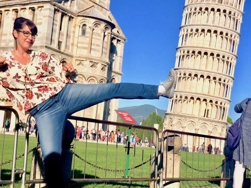 Safia kicks the tower of Pisa