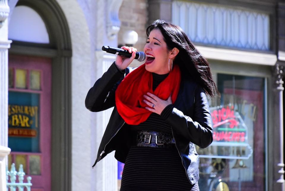 Safia Valines outside on microphone