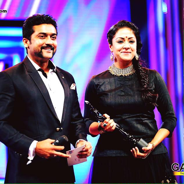 Actor Suriya presenting an award to Jyothika