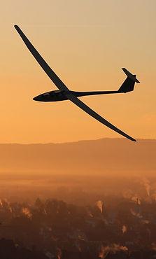 glider-pilot-city-morning-mood-lighting-