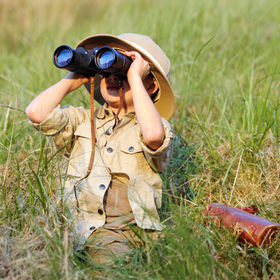 Young boy child playing pretend explorer
