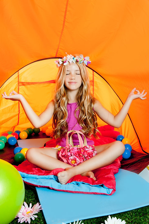 Blond little girl practicing yoga indoor
