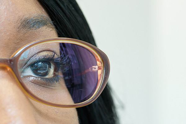 Image of a lady looking through spectacles