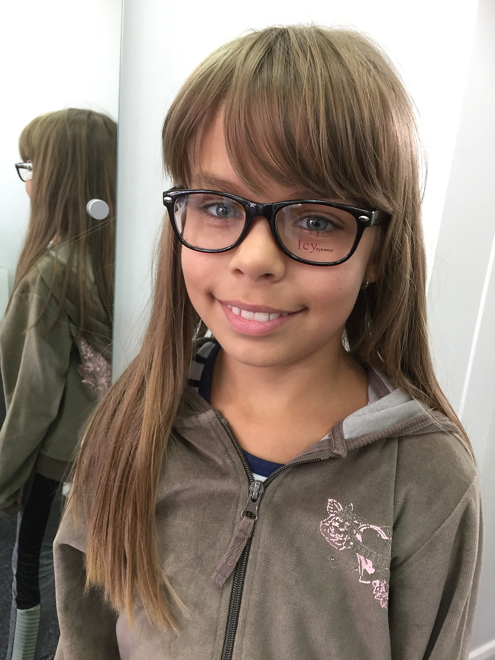 Child trying on frames at Cranford Opticians Hounslow, Heathrow