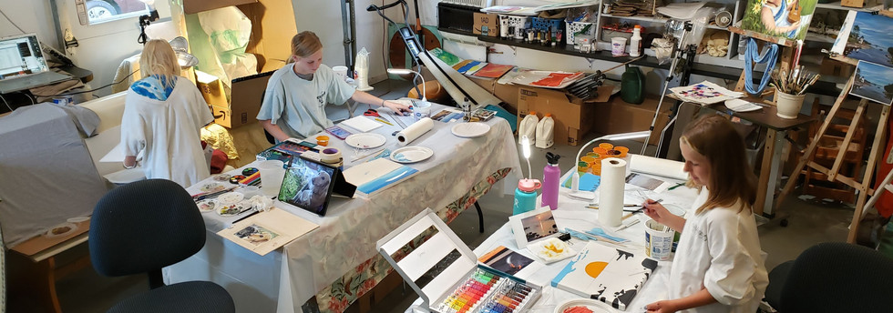 Students Painting with acrylics in garag