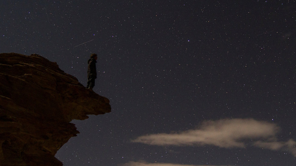 Rob Jansen is standing on a rock with a background full of stars.