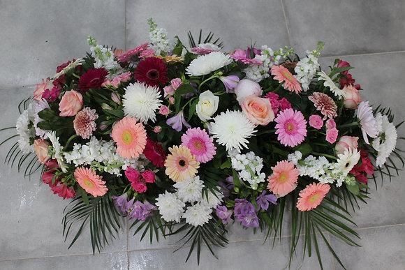 Dessus de cercueil teintes pastelles