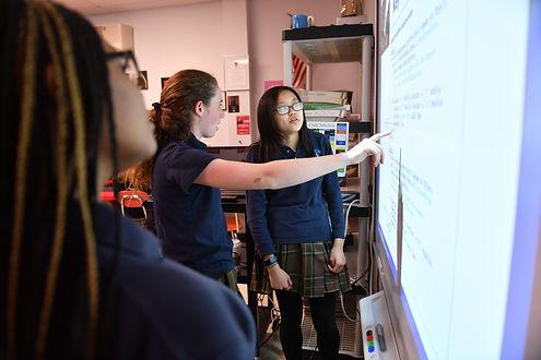 CS students code at board, CP.JPG
