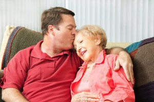 son kissing old mom