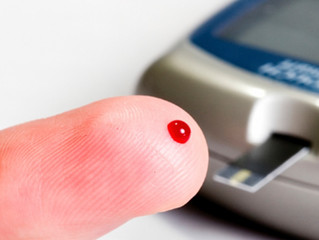 How many times a day should I check my blood glucose levels?