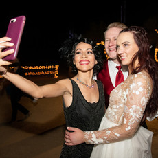 Singer Jackie Lopez taking a selfie with a happy Scottsdale bride and groom!