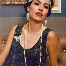 Arizona jazz vocalist, Jackie Lopez posing at a speakeasy bar.