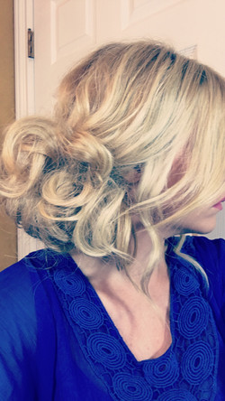 Messy Curled Side Bun