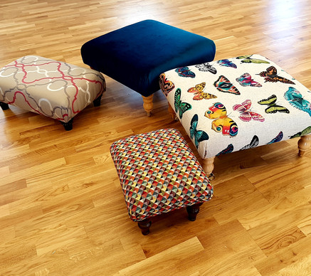 Four finished footstools