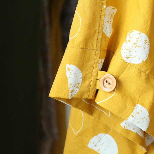 In-seam button loop made from self-fabric