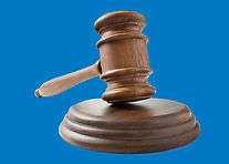 Wooden gavel on blue 2.jpg