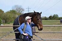 Horse Aria and Debbie at gate .JPG