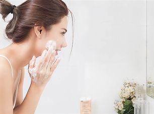 woman washing face.jpg