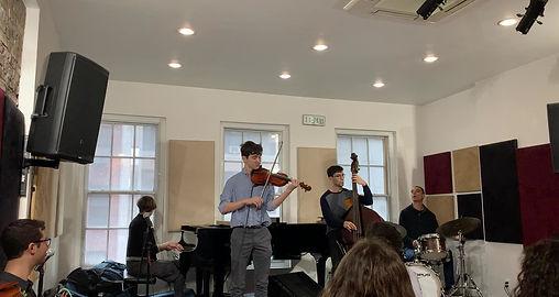 Benjamin's student, Ben Rubie performs during Benjamin's student recital in Jan. 2020