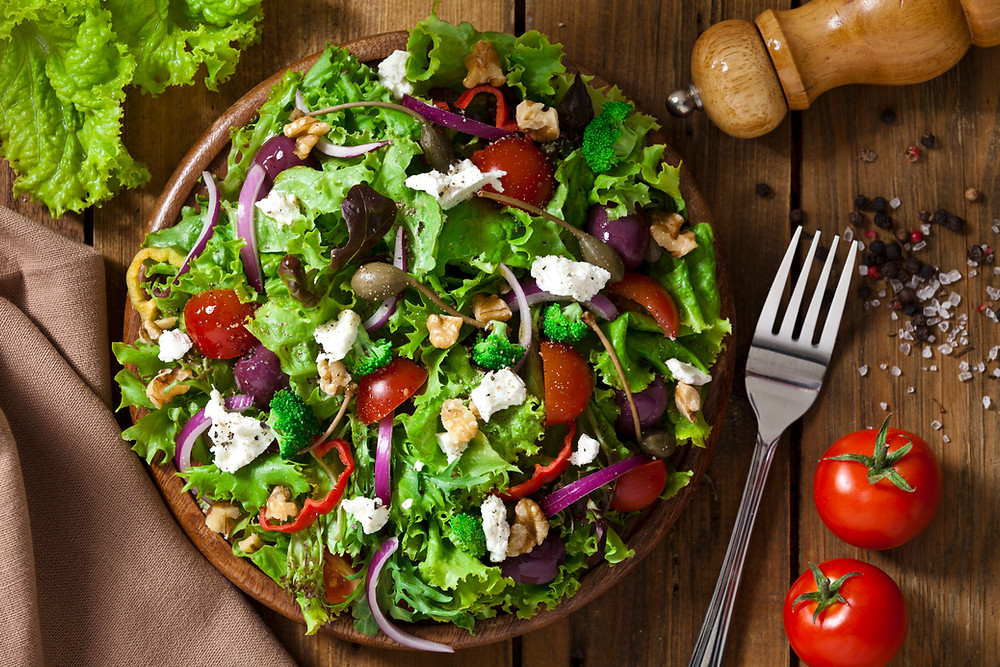 salad with fresh vegetables provides fiber needed for a healthy gut