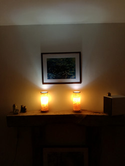 Lamps on mantle piece.
