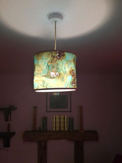 lamp shade switched on, click to go to shop