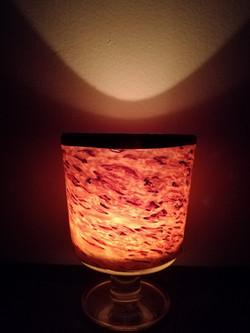 wine glass, candle light.