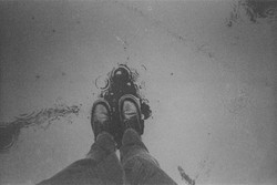 35mm lomography simple use black & white dr martens in rain
