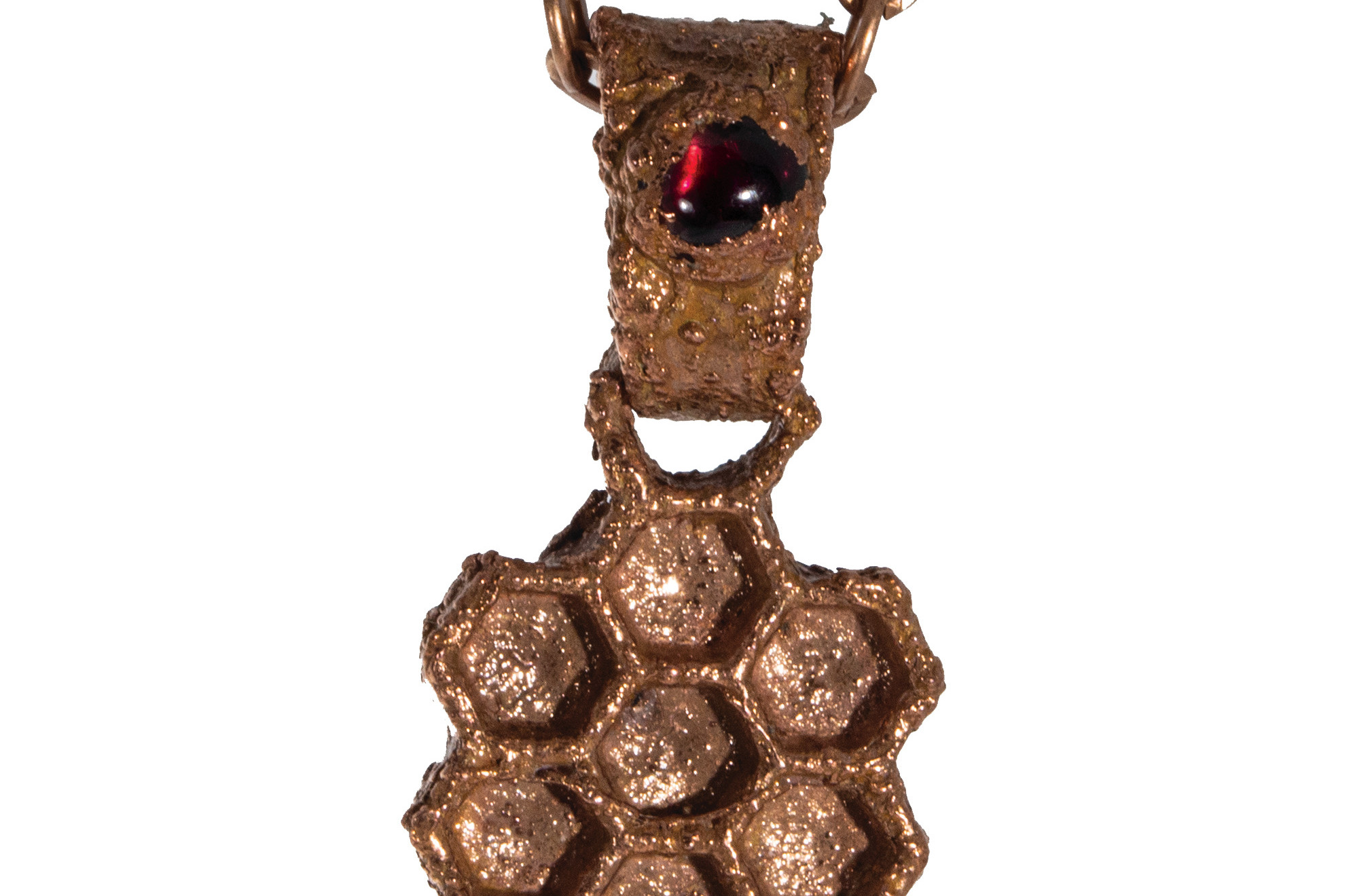 Real honeycomb slide from bee hive electroformed in copper with garnet crystal