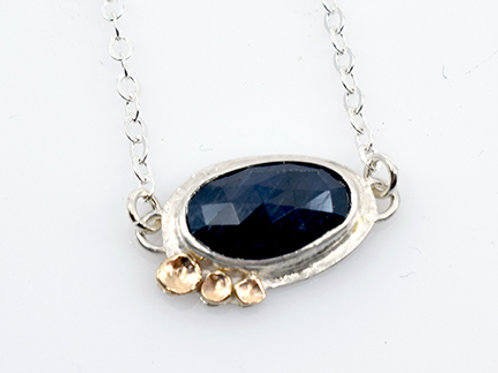 Raw Sapphire with 14K gold detail