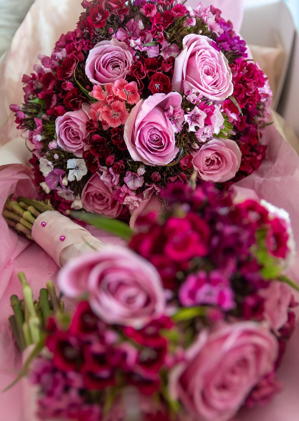Bride's hand-tied bouquet with roses and sweet williams