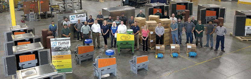 Pathfinder Systems employees with blower packages and sound enclosures