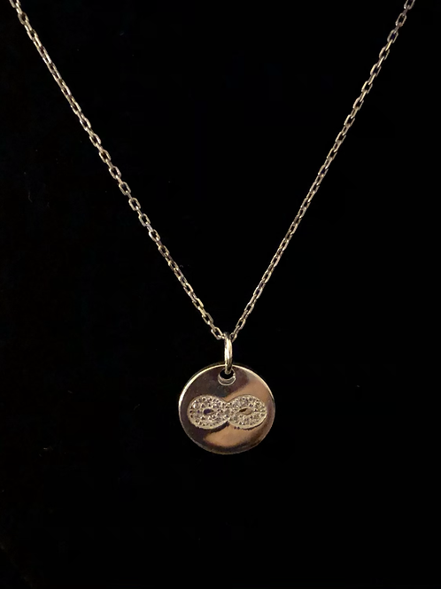 Infinity disc necklace