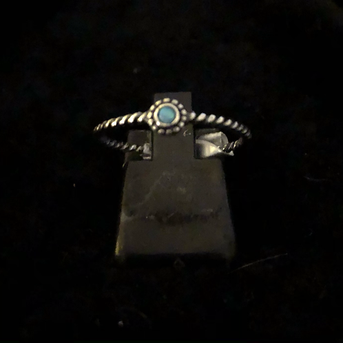Tiny blue stone set ring