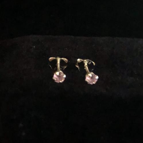 Tiny pink studs