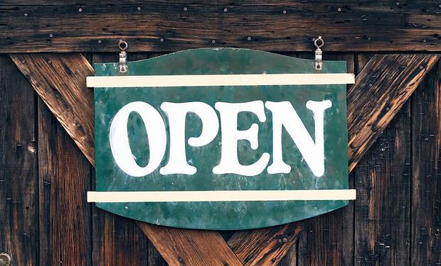Open Sign on a Wooden Door