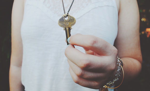 A woman handing over a key