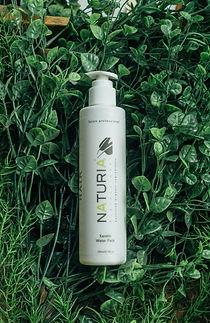 Naturia Organic Keratin Water Pack (250ml) covered in foliage