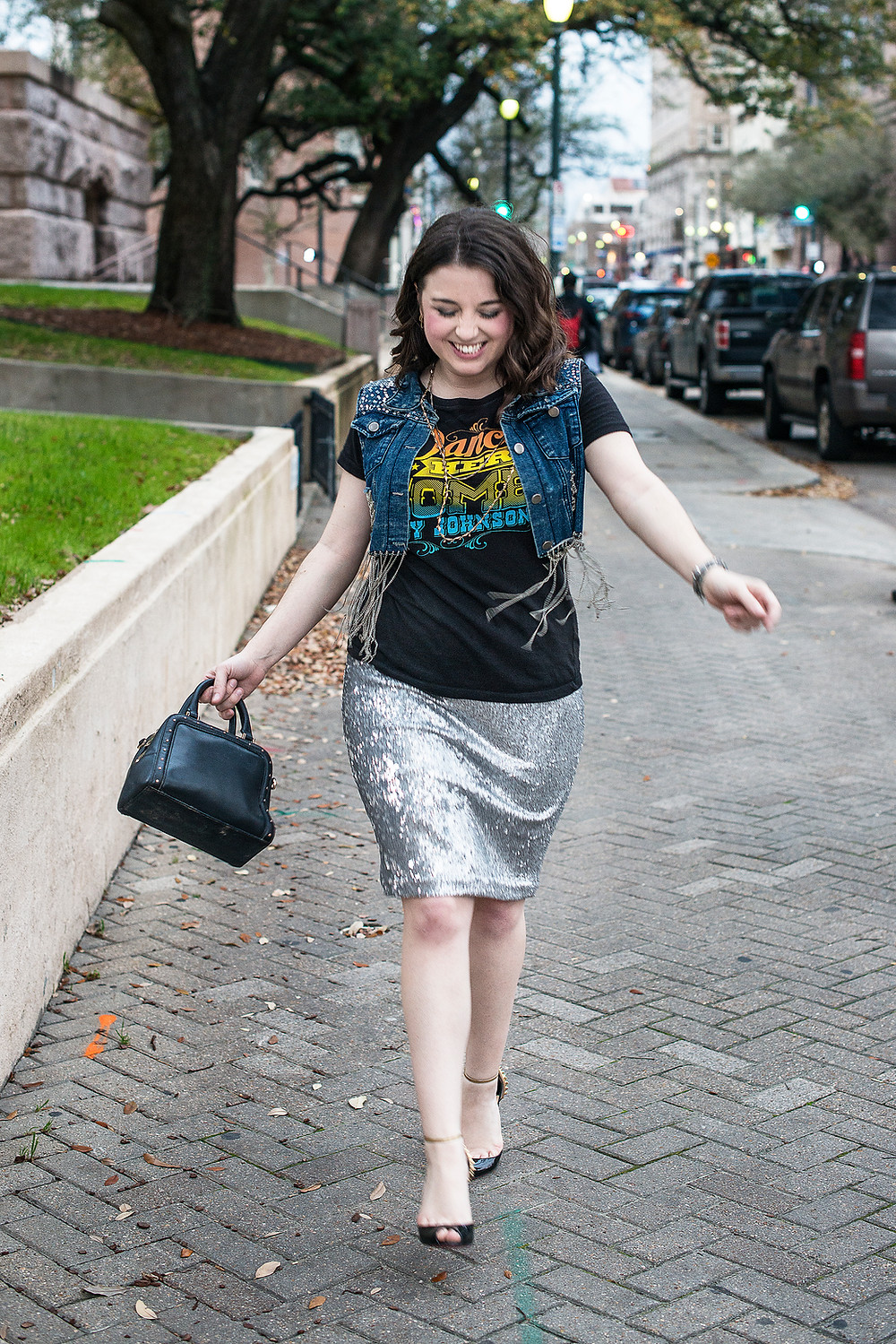 Personal Stylist in Houston pairs a graphic tee with a funky vest