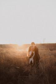 kansas city photographer man and woman in field sun set