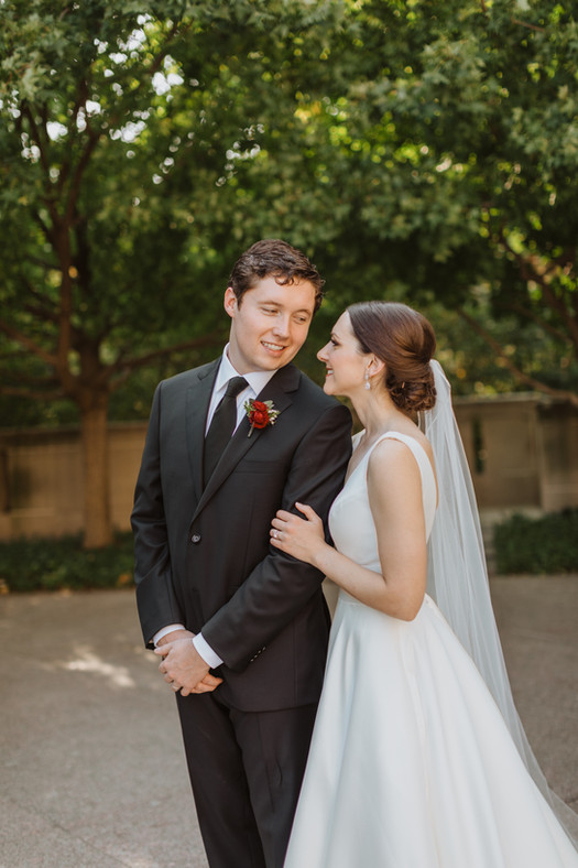 professional photographer kansas city bride groom hold each other