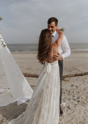 Bride and Groom Kissing candid wedding photo