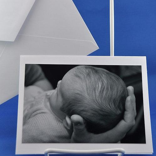 Baby Held Gently