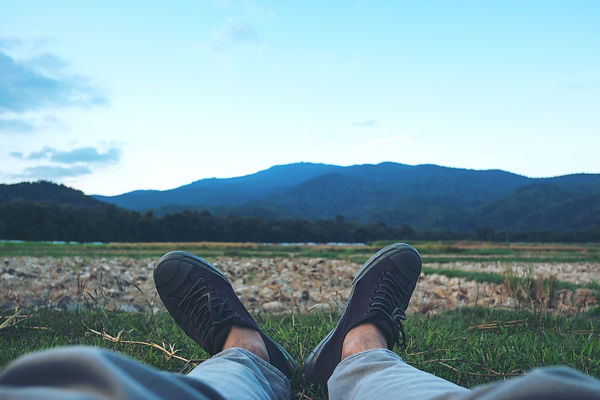 Lay down in field and green nature mount