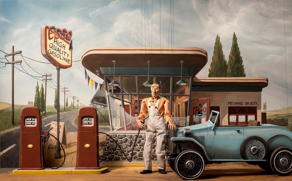 Walter Schmitty pumps gas