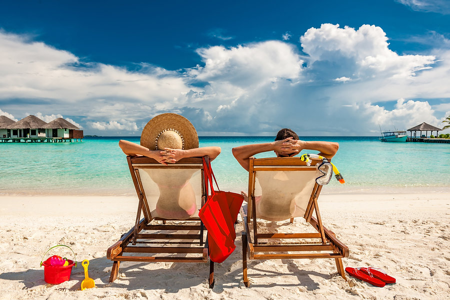 man-and-woman-relaxing-in-lounge-chairs-