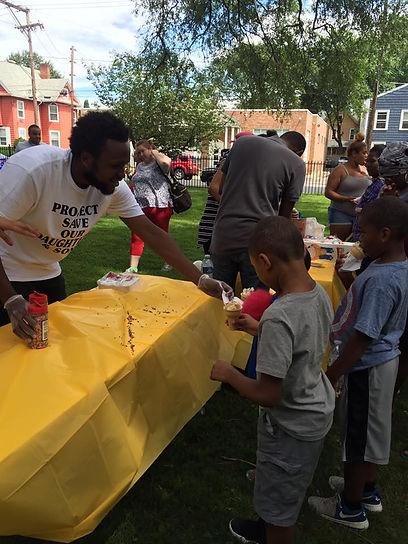 Man serving kids ice cream