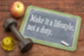 Make it a lifestyle, not a duty - fitness and healthy life concept  -  slate blackboard sign against