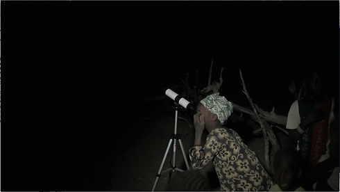 senegalese girl looking through a telescope.