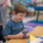 A kindergartener at a CSMA art class